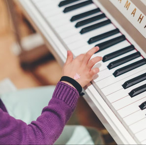 Child practicing piano.